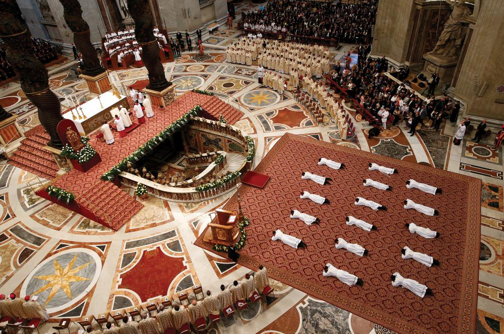 Newly ordained priests lie prostrate as Pope Francis leads a Mass in St. Peter Basilica at the Vatican, April 22