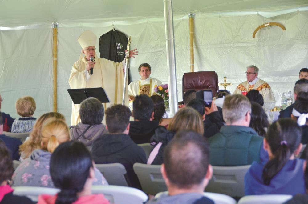 Bishop Earl Boyea's Mass on opening day of the Clinton County soccer league